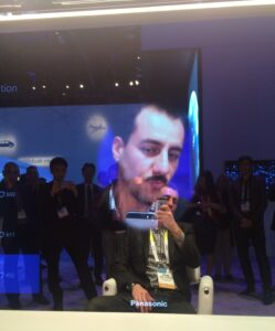 Trying on a moustache with the Smart Mirror.